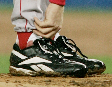 **FILE** Boston Red Sox pitcher Curt Schilling tends to his right ankle during the third inning of game 6 of the ALCS against the New York Yankees in this file photo taken on Tuesday, Oct. 19. 2004, in New York. Baltimore Orioles broadcaster Gary Thorne said Wednesday night, April 25, 2007, that Schilling painted the sock red as a public relations stunt in the Red Sox Game 6 win over the Yankees in the 2004 American League Championship Series. The famous bloody sock is now in the Baseball Hall of Fame in Cooperstown, N.Y. (AP Photo/Charles Krupa, File)